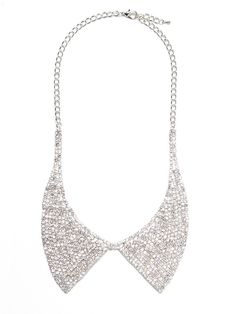 $36 The perfect topper to any outfit, this must-have collar style necklace mixes just the right amount of prim and proper with a shot of glam, via rows and rows of glittering crystals.  This is part of the ELLE Holiday Shop