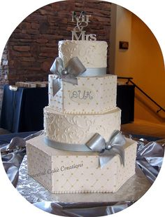 Elegant Ivory Wedding Cake with Silver Bows by Graceful Cake Creations, via Flickr