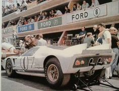 At the rear of this Ford GT40 is Crew Chief Gordon Chance, (aka The Teenage Tuner) at the 24hrs of LeMans 1965. The two Ford GT40s were the first 427s built by Kar Kraft... Crew and drives from Shelby American...