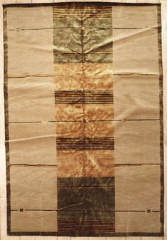This beautiful Handmade Knotted Rectangular rug is approximately 6 x 9 New Contemporary area rug from our large collection of handmade area rugs with Tibetan style from Tibet/Nepal with Wool/Silk