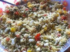 Roasted Garlic and Olive Couscous Salad Recipe    This mix-easy, make ahead side dish gets a punch of flavor from ripe Greek olives and fresh oregano!