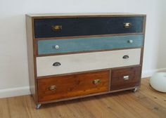 Great for a little boys room. I love that every set of drawers has a different color and knob.
