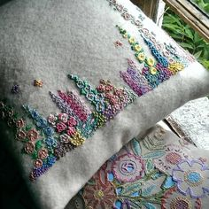 I've finished my hand embroidered cushion, adding several little butterflies and a lovely French floral fabric for the reverse. It's for the guest bedroom.just in time for my in-laws coming to stay with us next week.No photo description available. Hand Embroidery Stitches, Silk Ribbon Embroidery, Floral Embroidery, Cross Stitch Embroidery, Embroidery Patterns, Handmade Cushions, Embroidered Cushions, Floral Fabric, Sewing Crafts