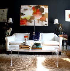 Dark walls, white, clear, natural jute, persimmons, browns, and hits of yellow-green...