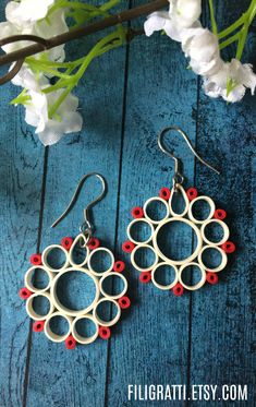 Make a style statement with these circle earrings. They are handmade with superior quality quilling strips. #HandmadeEarrings, #PaperQuilling, #StatementEarrings, #RedWhiteEarrings, #EtsyFinds