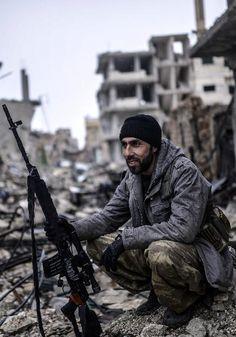 War with the Islamic state - Kurdish sniper in Kobani, Syria.