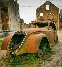 Decayed Peugeot 202 and some buildings in Oradour-sur-Glane, France | by whereswiwi