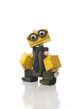 nerd wooden toy robot with glasses and tie