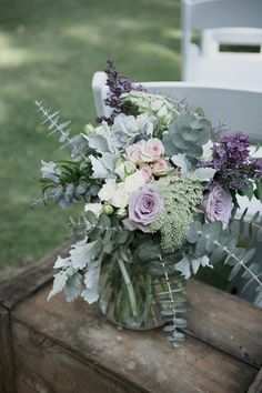 Pale purple and silver flower arrangement for rustic wedding ceremony