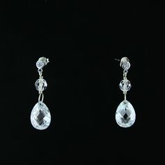 Delicate and subtle earrings made of silver, transparent cubic zirconia and Swarovski crystals.
