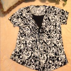 Brittany Black Ladies Plus Size Blouse, 1X This is a beautiful Brittany Black brand ladies blouse. It is made from 96% polyester and 4% spandex. The color is black and white, size 1X. No buttons, no zippers, completely slip on and machine washable. This is a gently used item in very good condition. Brittany Black Tops Blouses