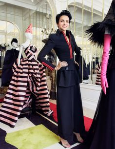 Farida Khelfa models some of Schiaparelli's latest designs as they introduce their new designer. The House of Schiaparelli has been around since the 1930s and she was the first designer to bring exposed zippers into high fashion. Her influence is carried into today's designs like in this jacket boldly displaying zippers in red both down the front and up the sleeves.