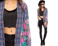 Vintage 80s kimono jacket with a floral and paisley print in purple. Open wrap front. Lightweight and oversized.    Every item we sell is authentic