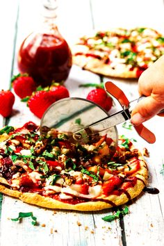 Strawberry Pizza with Fresh Mozzarella, Basil, and Balsamic Reduction   http://cookswithcocktails.com/strawberry-pizza-with-fresh-mozzarella-basil-balsamic-reduction/