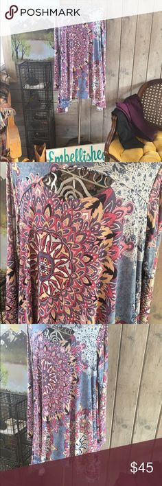 🇺🇸 tunic key hole print top woman & plus sizes Beautiful tunic with key hole front and spandex blend made in USA. Print pink and purple multi colors. Wear with plum purple leggings to black. On sale in my boutique closet to. Embellished cowgirl boutique tags attached fits true embellished cowgirl Tops Tunics