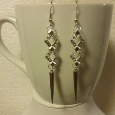 This pair of earrings are crafted with silver fish hook ear wire, silver jump rings, silver head pins, double cut out diamond shaped crystal &