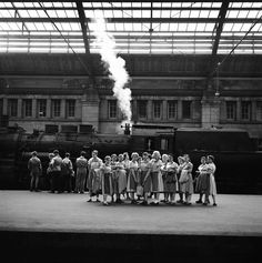 Schoolgirls in the Train Station, Germany, 1956 by Bill Perlmutter