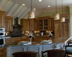 eclectic kitchen by Blue Sky Building Company  cabinet color/wood grain
