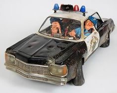 Highway Patrol Police Car Sculpture by artist Guillermo Forchino. Discover the entire comical collection at AllSculptures.com
