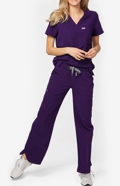 Featuring a stylish curved hem and side panel detail, our Ica pant has a flattering relaxed fit and a wide leg. With ten functional pockets, including smart storage for scissors, our Ica wide leg scrub pant is super functional and super stylish. Leg Scrub, Scrub Pants, Critical Care Nursing, Smart Storage, Wide Leg Pants, Scrubs, Jumpsuit, Suits, Stylish