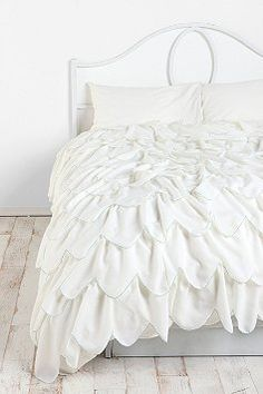 White scalloped duvet will hide your dark bedspread. http://www.urbanoutfitters.com/urban/catalog/productdetail.jsp?id=24096455&color=011&itemdescription=true&navAction=jump&search=true&isProduct=true&parentid=A_BED_D