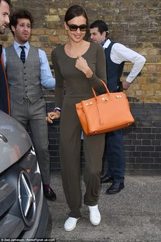 Sunny feeling: Irina Shayk was spotted leaving her London hotel on Wednesday morning in a khaki jumpsuit