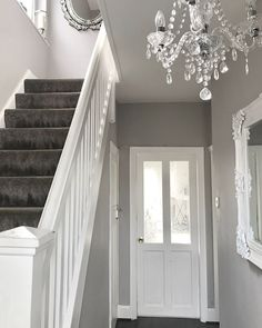 Narrow white hallway in 2019 hallway lighting ideas дизайн д Grey And White Hallway, Grey Carpet Hallway, Carpet Stairs, Grey Stair Carpet, Grey Wallpaper Hallway, Dark Grey Carpet Living Room, Grey Living Rooms, Grey Walls And Carpet, Light Grey Walls