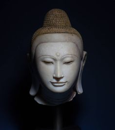 Buddha Head   Burma, Konbaung dynasty (1752-1885) or Shan States   18th or 19th century   Carved marble with traces of paint and lacquer   Height: 30 cm