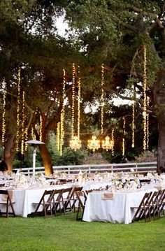 Cascading lights and chandeliers can give an outdoor wedding reception space an enchanted fairytale ambiance.