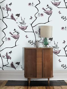Pavillion Birds wallpaper in blue and pink. Painted birds and trees in this classic wallpaper by Louise Body
