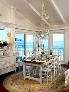 What a beautiful setting to eat by the beach in your Rhode Island Beach House.  We can make this happen for you.  Call us and we can transform a dining experience with a spectacular waterview. #RhodeIslandBeachHouse
