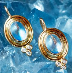 gorgeous blue moonstones set in double bezel 18 karat gold with diamond set granulation