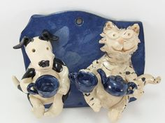 cat-dog teaparty sculpture by Gary Rith