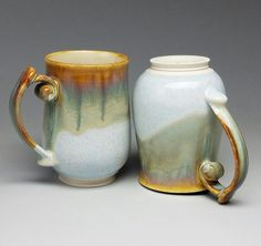 Swirl handled waterfall mugs! I love these guys. The drips are beautiful and the handles are easy and comfortable to hold. These mugs are for sale in the #Mudfire gallery. If you are interested in these mugs please message me. #kaiceramics #ceramics #porcelain #handmade #handmadepots #handmadeceramics #mudfire #madeatmudfire #mugs #porcelainmugs #handmademugs #swirlhandlemugs