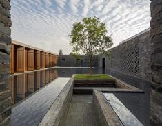 Neri&Hu encloses guest rooms and gardens within grid of brick walls