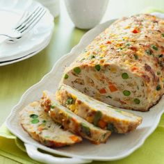 Chicken-Vegetable Meatloaf Recipe -- Thawed frozen vegetables make a quick and easy addition to this chicken meatloaf. Meatloaf Recipes, Meat Recipes, Food Processor Recipes, Chicken Recipes, Cooking Recipes, Recipe Chicken, Yummy Recipes, Ground Chicken Meatloaf, Chicken And Vegetables