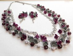A grey violet necklace earrings jewelry set.    This multi stand necklace features hand sculpted grey and violet lilacs decorated with Czech glass