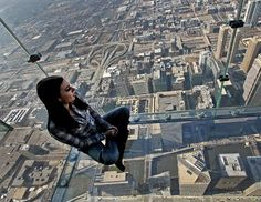 A girl sits on the glass balcony at the skydeck of the Willis Tower in Chicago, Illinois, Feb. 13, 2013. Willis Tower, formerly named the Sears Tower, is the tallest building in the U.S. and one of the most popular tourist destinations in Chicago with over one million visitors to its observation deck each year. (Tim Boyle/Bloomberg via Getty Images)