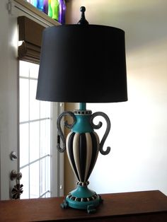 The artist of this gorgeous lamp is one of my students, created during one of my classes.www.furnitureartbygerri.com