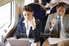 Businesswoman Commuting To Work On Train And Using Laptop royalty-free stock photo