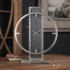 """Clock featuring a lightly antiqued silver champagne frame and stand with an exotic looking, mottled black veneer accent. Requires one """"AA"""" battery. Size: 15 W X 20 H X 3 D Metal Clock, Wood Clocks, Metal Art, Modern Clock, Modern Desk, Barn Wood Picture Frames, Diy Clock, Mantle Clock, Rustic Wall Decor"""