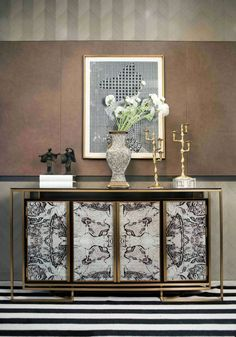 Starting off our impressionable entryways is this attractive entrance that mixes black and white patterns and oriental touches throughout the design. The striking storage cabinet definitely makes a statement with the patterned doors and gold touches.  entryways 10 Impressive Entryways 10 Entryways that Make an Impression