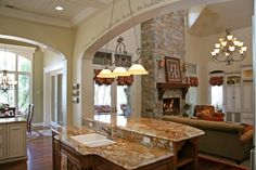 archways between rooms, fireplace, mantle, sconces on fireplace, floors