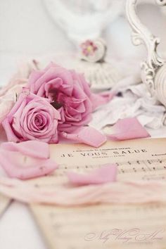 ...pink roses and antique sheet music...