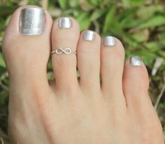 Tiny Infinity Sign Toe Ring , 925 sterling silver Adjustable Ring...Toe Ring/Knuckle Ring/Pinky Ring/Kids Ring. $12.50, via Etsy.