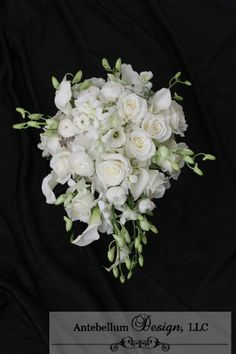 white cascade bouquet made with wedding flowers like orchids, ranunculus, and calla lilies, Dallas wedding flowers by AntebellumDesign.com