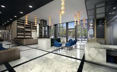 The marble clad lobby with a coffee bar in the back