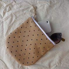 Dot Pouch:  punched leather and brass zipper  #pineandboon #polkadots #handmadeleatherbag