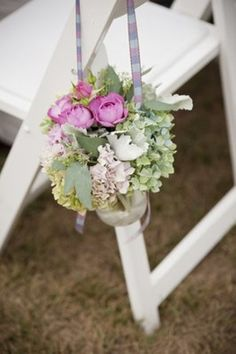 beautiful aisle arrangement using mason jar ribbon and beautiful delicate flowers. via:weddingomania /comments:walkingonsunshine:)