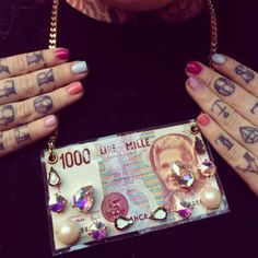 #jewels  #cool #girl #necklace #style #money #bijoux #fashion #collane #girl #fashionblog collane strane divertenti, funny stones necklace, mille lire maria montessori, fusa bijoux storenvy, etsy.com, kola payer , amanda marzlini,... Maria Montessori, Mille, Stone Necklace, Tattoos, Funny, Blog, Etsy, Bijoux, Rock Necklace